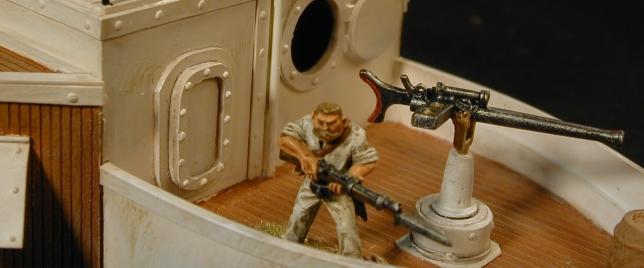 "Gunter mans the forward 1"" Pom Pom gun"