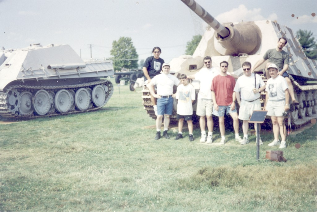 "Joe N. on left fender, Dave L, ?, Tim D, Chris A,Chris S, Bill W (me) and sitting on right fender of Jagd Tiger is ""I cant remember...lol!"