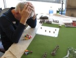"""The """"Agony of Defeat""""? or is he trying the Vulcan mind meld on his dice?"""